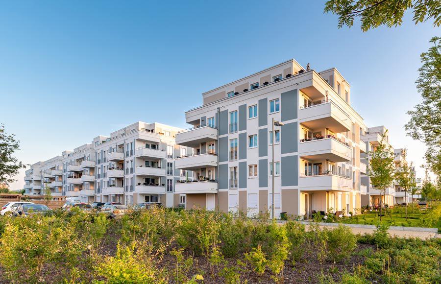 Wohnen an den Gärten der Welt - Blick auf die Stadtvillen und Riegelbebauung